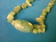 Jade.: Centro faceteado y jade al natural