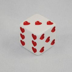 "This heart dice is white with red hearts for pips. At 25mm, it's bigger than most dice and feels good and solid. If you're looking for love dice, a good Valentine's Day gift, or if you're playing some kind of bizarre Cupid-themed role-playing game, these are the dice for you. With a range of 1 heart to 6 per side, this dice provides an easy way to answer the poet Elizabeth Browning's famous question, ""How do I love thee? Let me count the ways."" These dice are sol..."