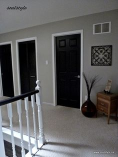Black Doors - Second Floor Black Interior Doors I've been wondering how this would look in my house & after seeing this I think it would actually look pretty good. Love the white trim against the black doors! via soulstyle Black Interior Doors, Black Doors, Home Interior, Luxury Interior, Painting Interior Doors, Interior Office, Interior Livingroom, White Doors, Interior Trim