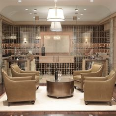 Chic basement wine cellar with seamless glass doors and exposed brick walls. Wine cellar with . Wine Cellar Basement, Home Wine Cellars, Home Wine Bar, Wine Cellar Design, Glass Wine Cellar, Wine Tasting Room, Tasting Table, Exposed Brick Walls, Cigar Room
