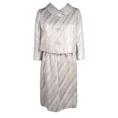 Silver lamé brocade dress with jacket. Brocade is woven into patterns of organic striations in shades of creamy white, subtle metallic gray and bright silver | Mainbocher (Main Rousseau Bocher, American, 1890-1976) | United States, 1960's