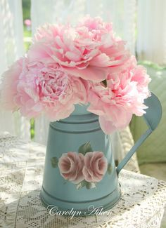 tin water can roses - cut flowers are Peonies