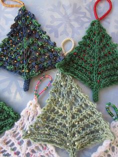 little knitted trees for the holidays, with beads for ornaments (or use a strand of holo sequins)
