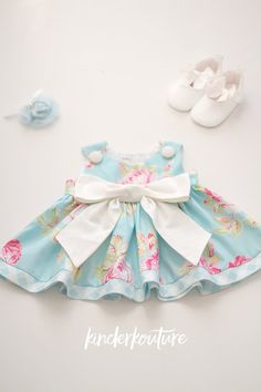 This gorgeous handmade baby dress is perfect for any special occasion. The blue rose colored cotton fabric is adorned with a large white bow, and buttons at the shoulders. Easy access, and easy care. Baby Girl Frocks, Frocks For Girls, Little Girl Dresses, Blue Dresses, Girls Dresses, Baby Girl Dress Patterns, Baby Dress, Marina Dress