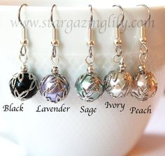 Sweet little earrings perfect for the holidays.  Glass Ball Earrings with Filigree Leaf Bead by stargazinglily, $4.50