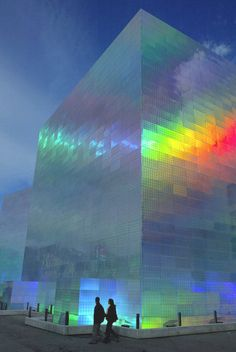 "ianbrooks: "" Holographic Cube Building by Hiro Yamagata Originally made for the Guggenheim Bilbao Museum, this installation covered two buildings in holographic panels that shifted color once lasers. Futuristic Architecture, Beautiful Architecture, Contemporary Architecture, Art And Architecture, Contemporary Building, Unique Buildings, Interesting Buildings, Amazing Buildings, City Buildings"