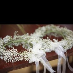 Flower girl crowns...have baby's breath (cheap) with beautiful lace ribbons in the back?  adorable with the tutu flowergirl dresses...