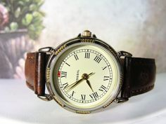 1990s FOSSIL Women's Watch with an Off White Face and Roman Numerals Watch with a Brown Genuine Leather Band by CarolsVintageJewelry on Etsy