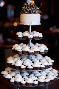 wedding cakes winter cupcake tower from a winter wedding Winter Wedding Cupcakes, Wedding Cupcake Table, Winter Cupcakes, Christmas Wedding Cakes, Purple Wedding Cakes, Wedding Cups, Wedding Cakes With Cupcakes, Wedding Desserts, Winter Wedding Foods