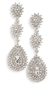 Crystal-encrusted teardrop pendants sparkle and shimmer on dramatic earrings destined to make a vintage-chic statement.