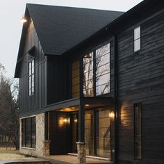 Defining Built & designed by is James Hardie in Sherwin Williams Iron Ore. Defining Built & designed by is James Hardie in Sherwin Williams Iron Ore. Exterior Siding, Exterior House Colors, Exterior Design, Barn Siding, Siding Colors, House Siding, Loft Interior, Black Barn, Black Wood
