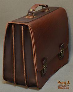 солидный мужской портфель из толстой кожи