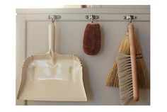 Martha Stewart's new utility room features Sugatsune swing hooks, which can fold flat when not in use