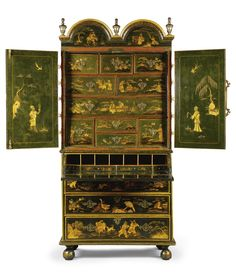 A Queen Anne dark green and gilt-chInoiserie japanned secretaire cabinet circa 1710 the double domed cornice with three replaced silvered finials above a pair of doors revealing an arrangement of ten drawers, the lower part with a secretaire drawer enclosing four drawers and pigeonholes, above three graduated long drawers on bun feet, decorated throughout with figures, pavilions and hunting scenes amongst trees and wildlife,