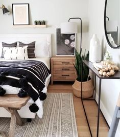 This Sophisticated Boho Bedroom Is a Texture Lover's Dream This boho-inspired bedroom nails the balance between whimsical and sophisticated, thanks in large part to its artful texture play. From the rug to the pom-pom throw to the decorative woven basket, Dream Bedroom, Home Bedroom, Bedroom Rugs, Bench In Bedroom, Bedroom Lamps, Lighting In Bedroom, Bed Room, Layered Rugs Bedroom, Bedroom Wall Shelves