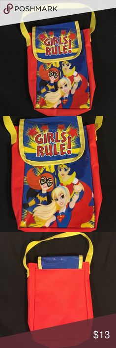 """DC Superhero Girls bag *lowest price* NWOT DC Comics bag with Velcro flap, featuring Batgirl, Wonder Woman, and Supergirl and says 'Girls Rule!'. Measures approximately 2""""x6""""x8"""". Blue background and red stars/letters are sparkly/glittery. There's a spot on the crease of the flap where the blue is a lighter shade (see photo) but otherwise no issues. *cross posted* DC Comics Accessories Bags"""