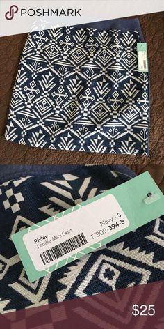 Mini skirt. Blue, patterned mini skirt. Never worn. Pixley Skirts Mini
