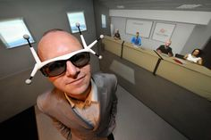 A man seeking a job was equipped with 3D spectacles with sensors as he trained in Clermont-Ferrand, central France with avatars (background) in a virtual reality cube, at business incubator Pascalis.