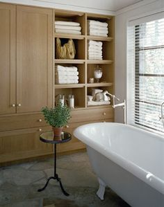 Built-ins in the bathroom are so convenient because they don't take up the extra space!