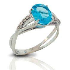 anel com pedra brasileira-topázio azul, brilhante e ouro.
