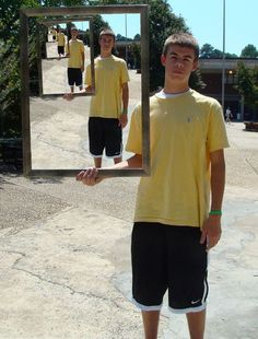 """""""Second PhotoShop project. They each took photos of themselves with a frame. They could then change either the inside, outside, or both backgrounds of the frame as long as it showed a part of their personality."""" - View 1"""