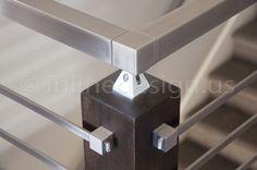 Inline Design stainless steel railing and custom dark wood posts