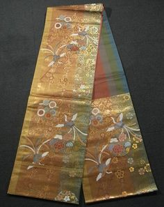 This is a graceful Fukuro Obi with seasonal flower such as 'kiku'(chrysanthemum), 'botan' (peony) and houou(phoenix) pattern, which is woven.