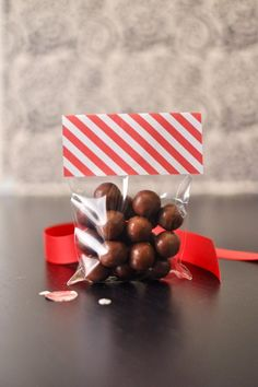 topping the cello bags with cute paper to seal = sweet, festive, easy favors for a party