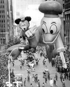 Mickey Mouse and Donald Duck celebrate the first anniversary of Walt Disney World at the parade in 1972. Description from d23.com. I searched for this on bing.com/images
