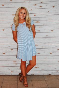 Looking for something cute and comfy? This lace up pocket dress is the perfect one for you!! ✨ www.champagnewishesbtq.com