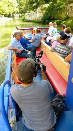 DP Mark Stitzer begins shooting a San Antonio River tour with tourists, on 9/24/2012