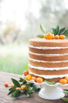 naked cake topped with kumquats, photo by Michael and Kate Photography http://ruffledblog.com/lake-hodges-wedding-inspiration #weddingcake #cakes