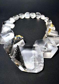 "Necklace | © Emmeline Hastings 2012 .  Carved perspex titanium 18ct gold  - "" WE EMBRACE ART & DESIGN."" entrenous by LE NOEUD www.enbyln.com"