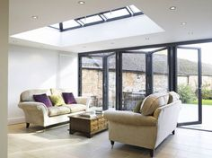skylight and bifold doors makes this room the perfect transitional Barn Door In House, Barn Doors For Sale, Roof Lantern, House Extensions, Kitchen Extensions, Interior Barn Doors, Sliding Doors, Front Doors, Sliding Wall