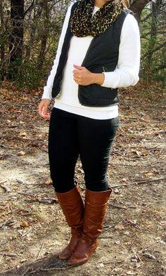 black vest, white sweater, leopard print scarf, cognac boots