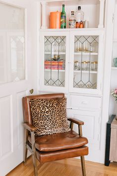 leather side chair with leopard print pillow