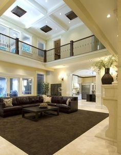 This is one of my favorite rooms. I love the two story coffered ceiling and open walkway with the dark railings on the second floor that wraps around the room. Gorgeous....V