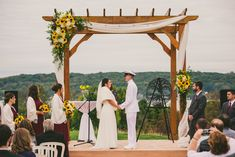 Sunflowers yellow wedding flowers roses wedding ceremony arch at Geneva National Resort in Lake Geneva Wisconsin Wedding Pergola, Wedding Ceremony Arch, Wedding Ceremony Decorations, Outdoor Ceremony, Wedding Arches, Wedding Decor, Yellow Wedding Flowers, Rose Wedding, Fall Wedding