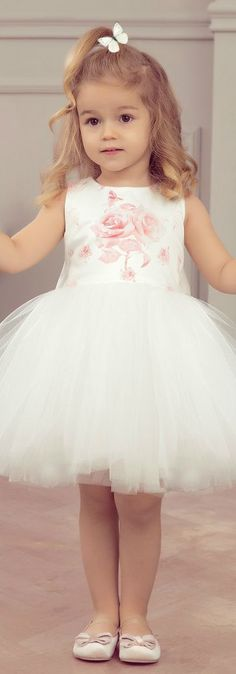 JUNONA Little Girls Designer White Tulle Rose Party Dress from the Spring Summer 2018 Collection. Love the vintage pink rose print on the satin bodice, with a delicate tulle overlay. Perfect vintage style party dress for a little princess at any special occasion or wedding. Pretty Style for for stylish kid, tween and teen girls. Shop at Childrensalon (affilaite) #kidsfashion #fashionkids #girlsdresses #childrensclothing #girlsclothes #girlsclothing #girlsfashion #flowergirl