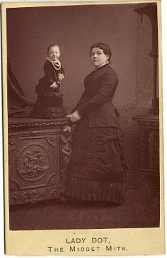 """Pauline Musters (February 26, 1876 - February 16, 1895), AKA """"Lady Dot, The Midget Mite"""" or """"Princess Paulina,"""" was a midget. She was 17 inches tall and weighed 8 1/2 pounds. SHe was the smallest recorded woman ever. She died of pneumonia when she was only 19 years old. A Dutch documentary on Pauline was made in 2002."""