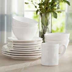 <p>Equally lovely for casual weeknight family meals and more upscale dinner parties alike, this must-have 16-piece dinnerware set adds a pop of polish to your tablescape.</p><p>Crafted of dishwasher-safe earthenware, each piece features a glossy glazed design in a solid hue for versatile style. With four place settings including a dinner plate, salad plate, bowl and mug, you can feel free to serve up nearly any snack or meal.</p><p>If you have open stor...