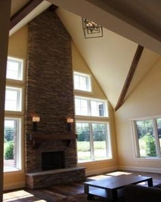 Stone fireplace- it looks so great with the tall ceilings!