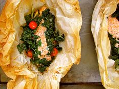 basic fish en papillote (left here as a reminder; for my own i used a bed of lemon slices + bulb of garlic, spinach and tomato wedges. wrapped in foil, not parchment, 450F 15-20mins)