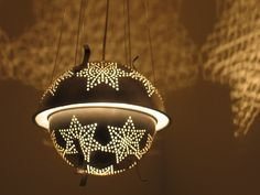 Vintage colander upcycled into lighting - Sputnik 1 star colander lantern. $135.00, via Etsy.