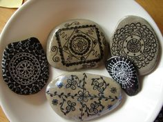 Plain rocks and a white or black calligraphy pen.