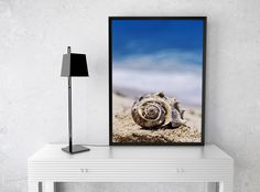 The Shell art print by Evgeniya Lystsova. Sea shell with sea as background on the seashore of Cancun, Mexico. Wonderful Wall Art to decorate your Home and Office. Make your Interior Design special and cosy. Available as Art Prints (framed, wood, acrylic, metal), Canvas Prints, Posters and Decor Products (towels, throw pillows, duvet covers, tote bags and coffee mugs). #EvgeniyaLystsovaFineArtPhotography #Coastal #Shell #Beach #Prints #HomeDecor #Canvas