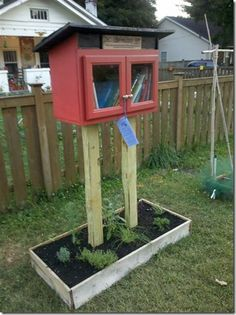 little free library and gleaning gardens the herb garden the LFL.   the herbs here are dwarf lavendar, thyme, dill, sage, chives, chamomile, rosemary,