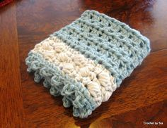 Spa Washcloth - free crochet pattern. Very pretty and simple. However, my hand was killing me after the three rows of puff stitches! I will definitely make more of these.