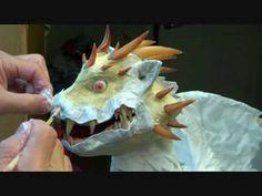 Dan Reeder's website. He makes AMAZING paper mache dragons. Tons of process videos!