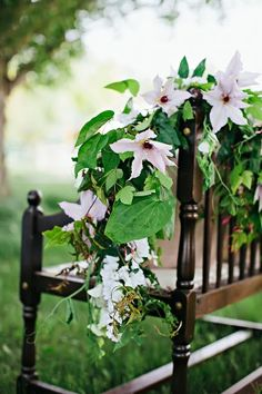 White flowers and greenery garland on bench | photography by http://www.jaclyndavis.com/blog/ and floral design by http://www.lemonblossomdesigns.com/blog/
